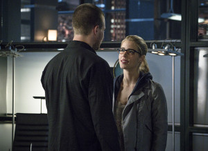"Arrow -- ""My Name is Oliver Queen"" -- Image AR323B_0282b -- Pictured (L-R): Stephen Amell as Oliver Queen and Emily Bett Rickards as Felicity Smoak -- Photo: Liane Hentscher/The CW -- © 2015 The CW Network, LLC. All Rights Reserved."